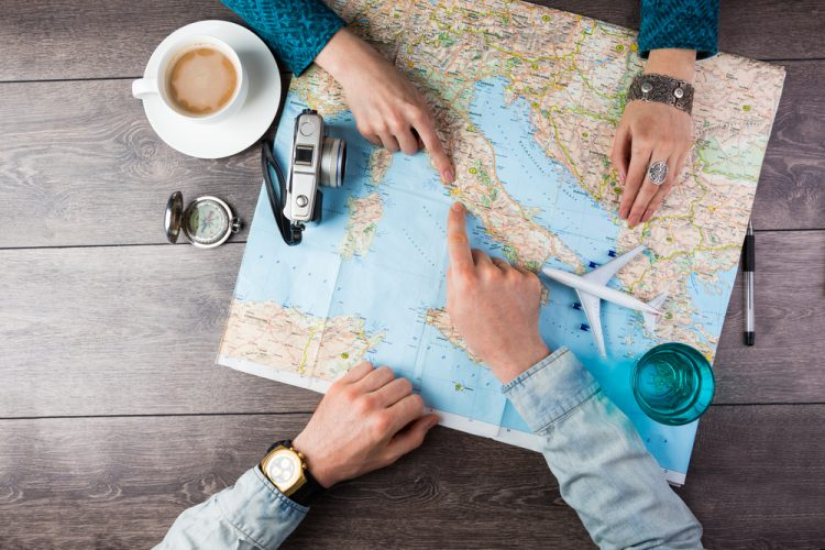 Couple searching a map